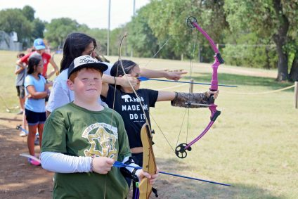 Boy and Girl at Camp Archery